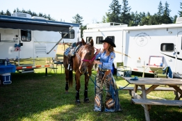 St. Paul Rodeo Princess Britney Norby gets her horse Huckleberry ready for an afternoon in the stables on Friday, June 30, 2017. The three court members and their horses had a 5 a.m. call time for television interviews on the first day of the rodeo, with the rodeo itself starting at 7:30 p.m. that night.
